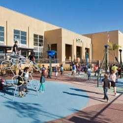 Photo of High Tech Elementary playground with students playing